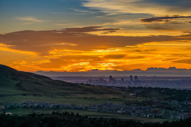 Sunrise - Denver, Colorado A stunning sunrise over Denver, as seen from Red Rocks Amphitheatre in Morrison, Colorado. alameda california stock pictures, royalty-free photos & images