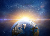 Sun rising over Greenland and Arctic from space. Giant meteor explosion on planet Earth. Global warming concept. 3D illustration - Elements of this image furnished by NASA (https://eoimages.gsfc.nasa.gov/images/imagerecords/73000/73605/world.topo.bathy.200402.3x5400x2700.jpg)