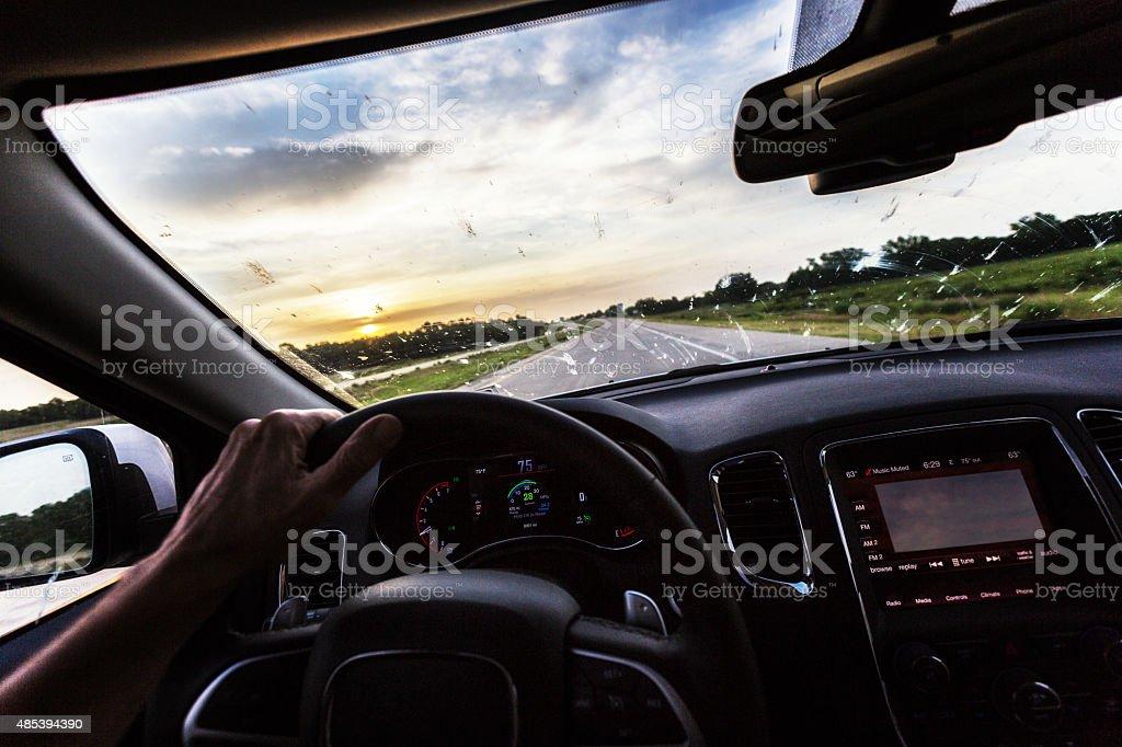 Sunrise Expressway Driving Filthy Windshield Splattered Bugs stock photo