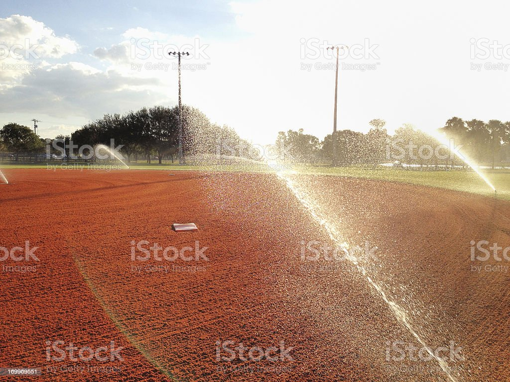 Sunrise field maintenance royalty-free stock photo