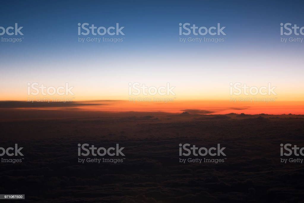 Sunrise from a plane - red gradients stock photo