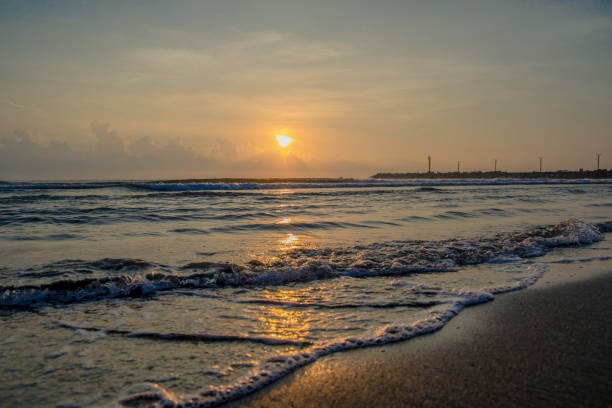 Sunrise from Boca del Río, Veracruz A sunrise from the mouth of the river, Veracruz, taking into account the bottom breakwaters and fishermen in their respective boats. veracruz stock pictures, royalty-free photos & images