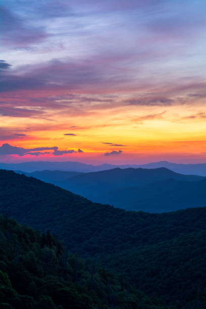 Sunrise From East Fork Colorful sunrise over the Blue Ridge Mountains from the East Fork Overlook along the Blue Ridge Parkway in Western North Carolina. blue ridge mountains stock pictures, royalty-free photos & images