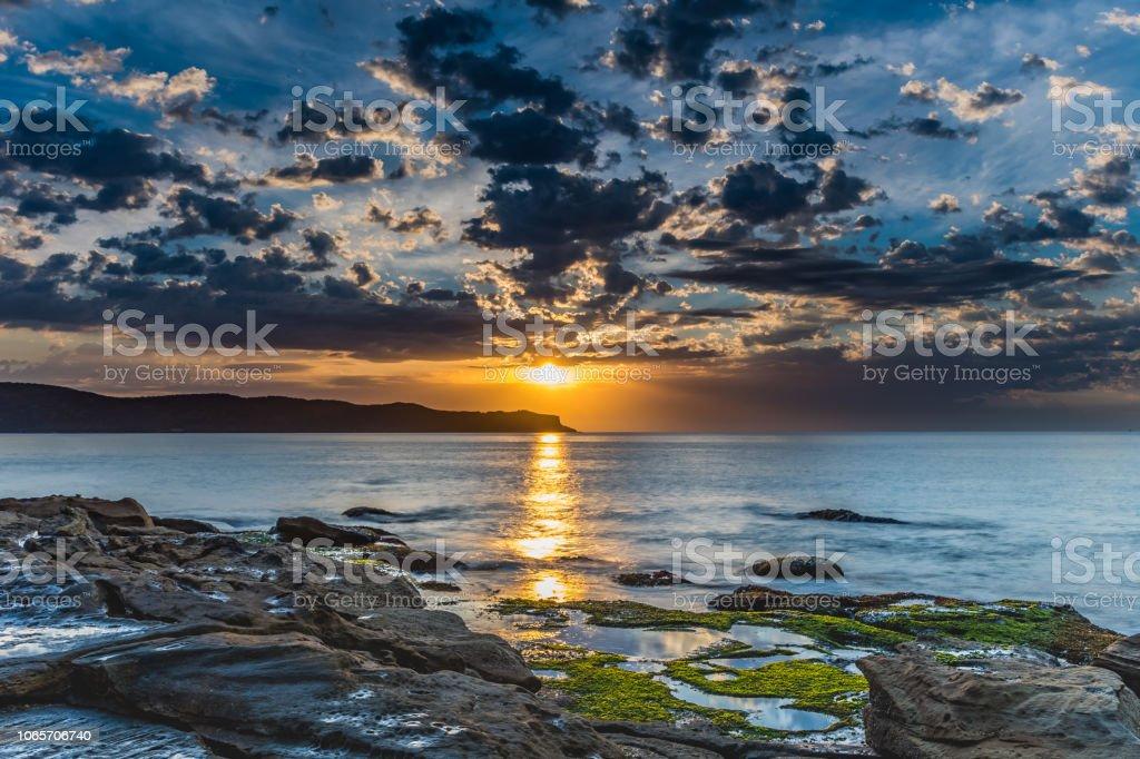 Sunrise Glory at the Beach stock photo