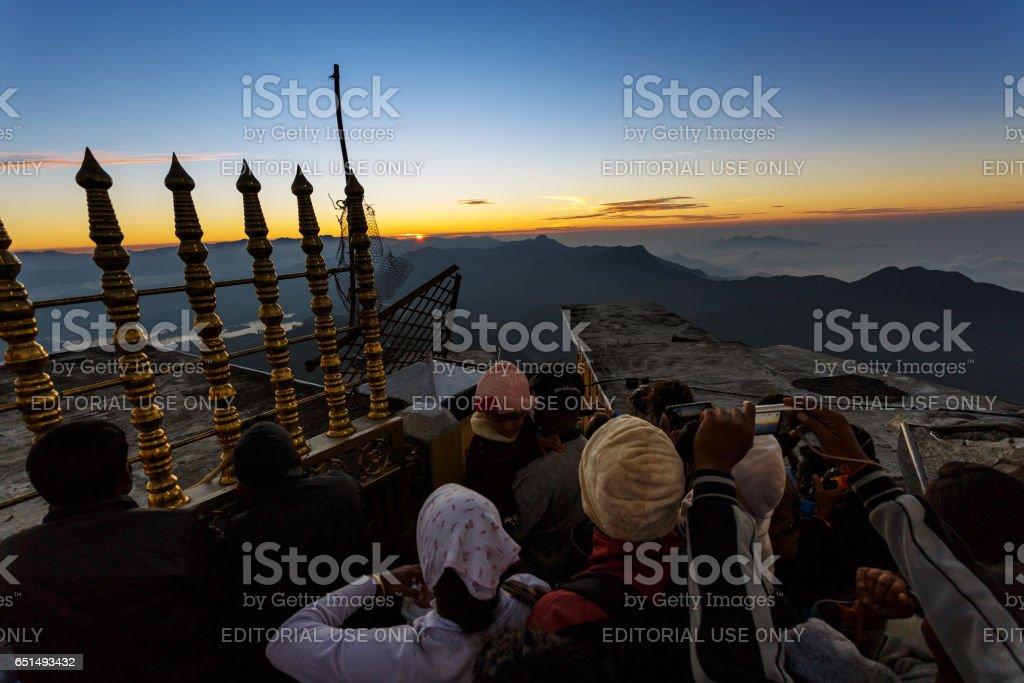 Sunrise greeted pilgrims on the holy mount Adams Peak stock photo