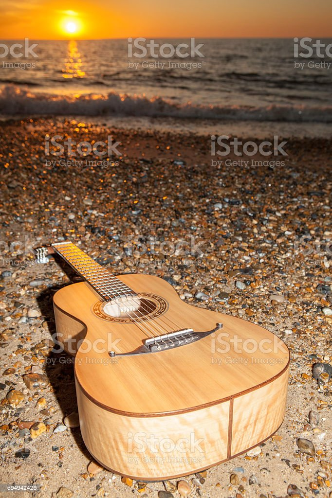 Sunrise guitar - after the vacation party! stock photo