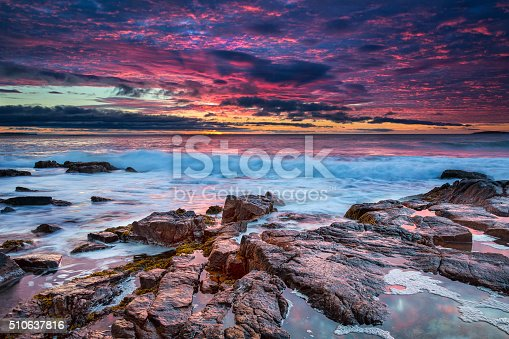 A beautiful sunrise at the rocky beach of Thunder Hole in Acadia National Park, Maine, USA.