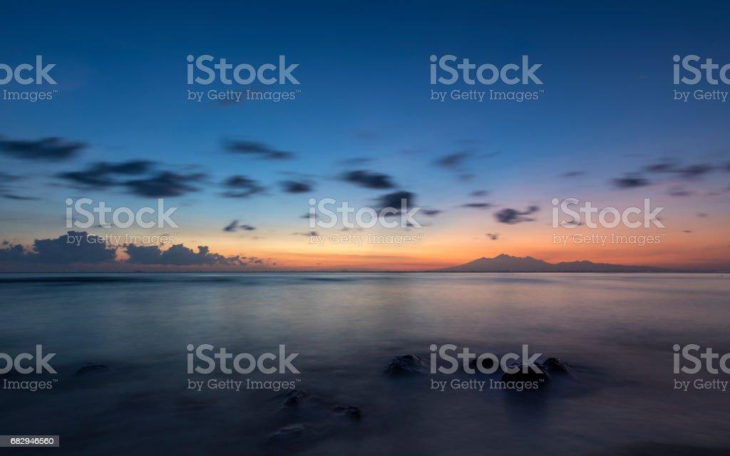 Sunrise in Amed in Bali with volcano Rinjani in horizon royalty-free stock photo