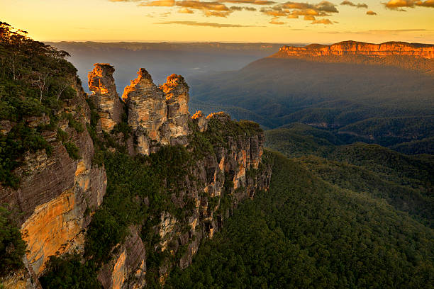 "Sunrise in Blue Mountains View over the landmark rock formation ""Three sisters"" in Blue Mountains, NSW, Australia on sunrise.  australia stock pictures, royalty-free photos & images"
