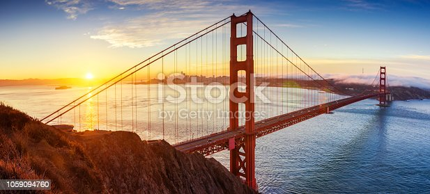 Panoramic view of Golden Gate bridge at sunrise in San Francisco, California. United States