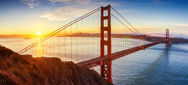 Panoramic view of Golden Gate bridge at sunrise in San Francisco, California. United States