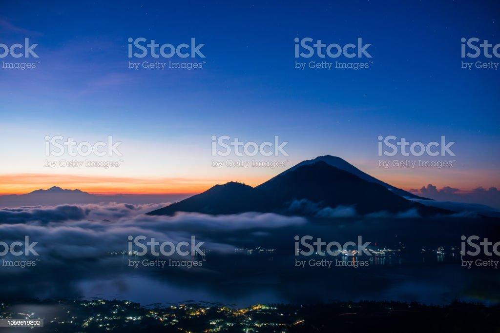 sunrise in indonesia, morning at batur sunrise in indonesia view of volcano agung from batur Adventure Stock Photo
