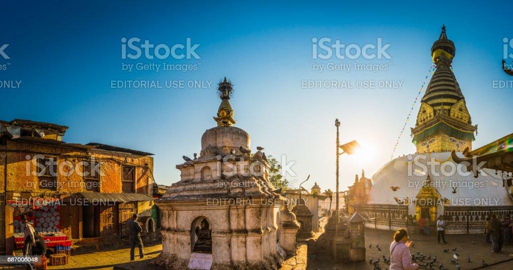 Sunrise in Kathmandu pilgrims at Swayambhunath monkey temple panorama Nepal stock photo