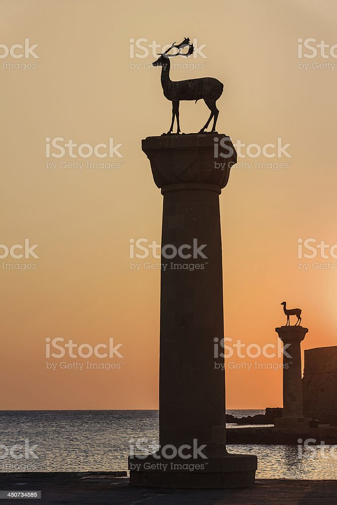 sunrise in Mandraki harbor. Rhodes, Greece stock photo