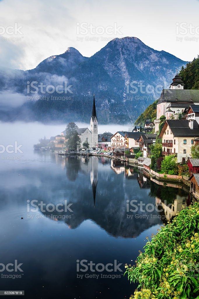 Sunrise in misty Hallstatt stock photo