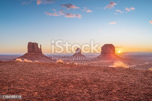 Stock photograph of the Mittens and Merrick butte in Monument Valley, Arizona, USA during sunrise.
