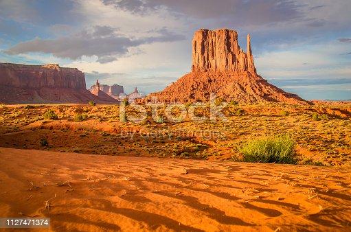 Sunrise in red-sand desert region on the Arizona-Utah border, known as Monument Valley