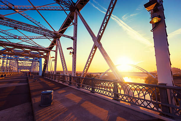 Sunrise in Nashville Shelby Avenue Bridge in Nashville, Tennessee, USA. middle of the road stock pictures, royalty-free photos & images
