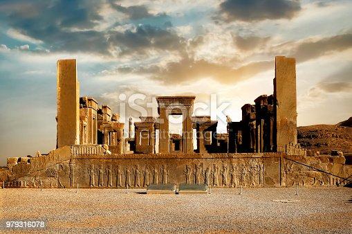 Sunrise in Persepolis, capital of the ancient Achaemenid kingdom. Ancient columns. Sight of Iran. Ancient Persia. Beautiful sunrise background.