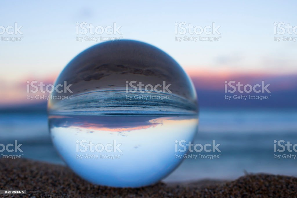 Sunrise in Pink and Blue taken through Glass Sphere stock photo