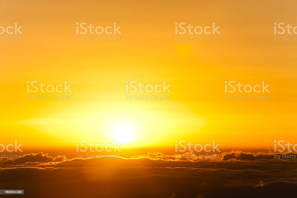 sunrise in sea of clouds stock photo