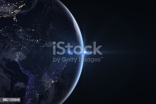 istock Sunrise in space with earth, solar energy concept. 980105946