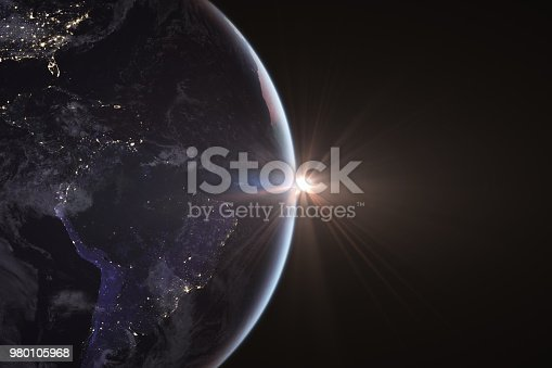 istock Sunrise in space with earth, solar energy concept. 980105968