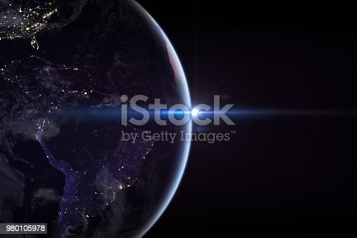 istock Sunrise in space with earth, solar energy concept. 980105978