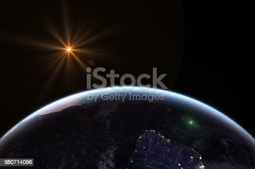 istock Sunrise in space with earth, solar energy concept. 980714096