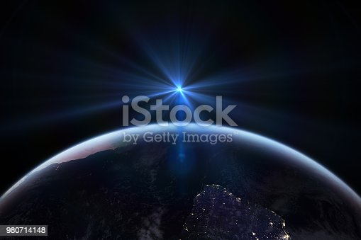 istock Sunrise in space with earth, solar energy concept. 980714148