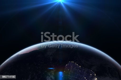 istock Sunrise in space with earth, solar energy concept. 980714192