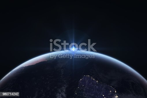 istock Sunrise in space with earth, solar energy concept. 980714242