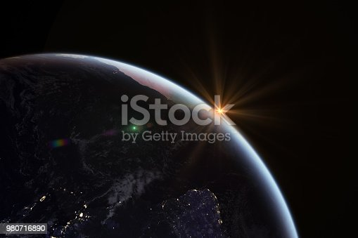 istock Sunrise in space with earth, solar energy concept. 980716890