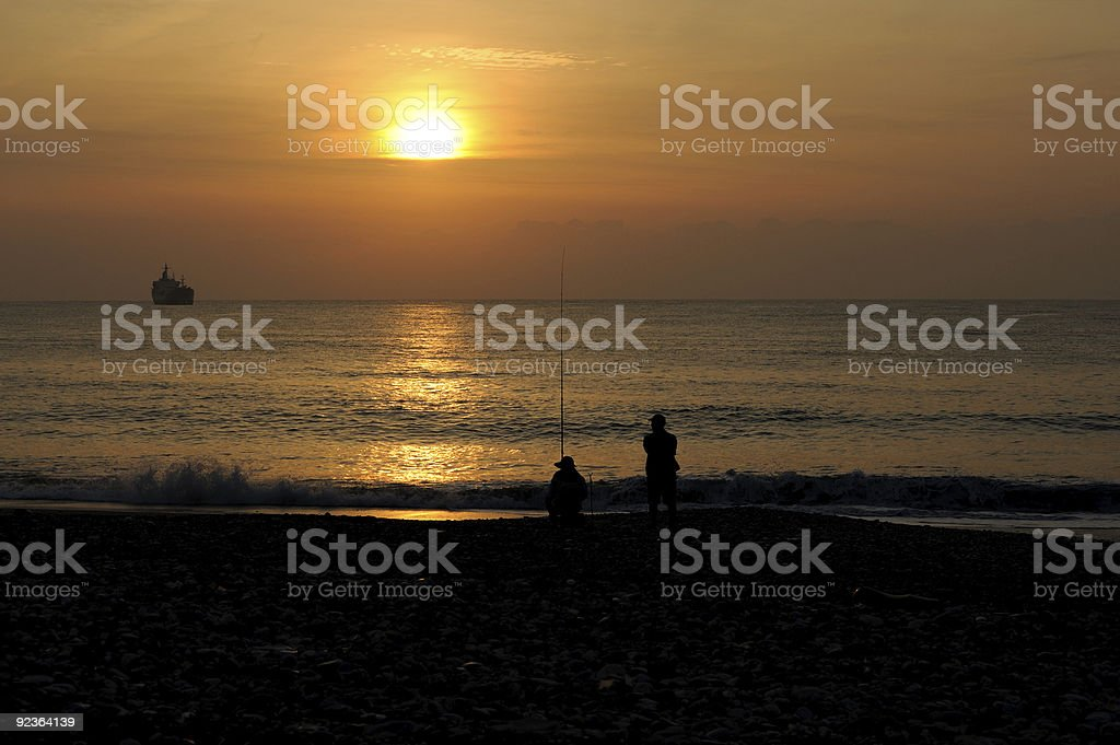 Sunrise in Taiwan Hualien Pacific coast with fisherman royalty-free stock photo