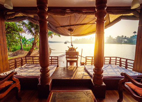 Houseboat on Kerala backwaters early in the morning - India
