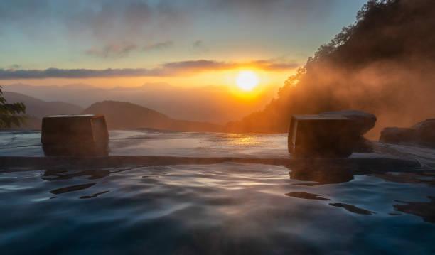 Sunrise in the Japanese hot spring, Yari Onsen, Hakuba, Japan Sunrise in the Japanese hot spring, Yari Onsen, Hakuba, Japan hot spring stock pictures, royalty-free photos & images