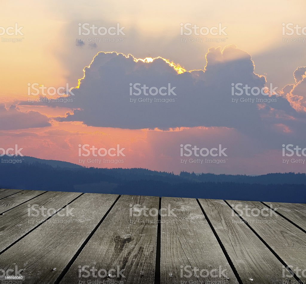 Sunrise in the mountains and empty wooden deck table. royalty-free stock photo