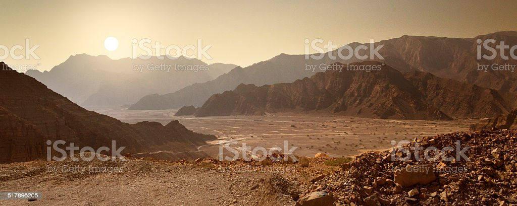 Sunrise in the Musandam desert in Oman stock photo