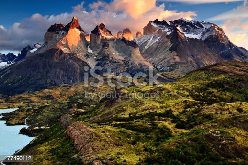 An early morning sunrise landscape photograph of the Cuernos del Paine, or \