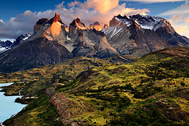 Sunrise in the Patagonian Andes Mountains An early morning sunrise landscape photograph of the Cuernos del Paine, or