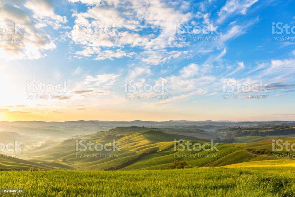 Sunrise in the rolling rural landscape stock photo