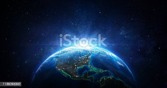 istock Sunrise In The Space - Blue Earth With City Lights - Usa elements of this image furnished by NASA - 3d Rendering 1139263302