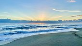 Multicolored sky over a rough tropical ocean