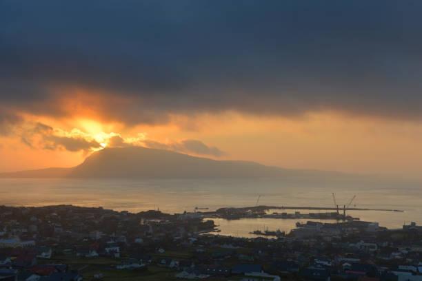sunrise in torshavn - imagean faroe islands stock photos and pictures