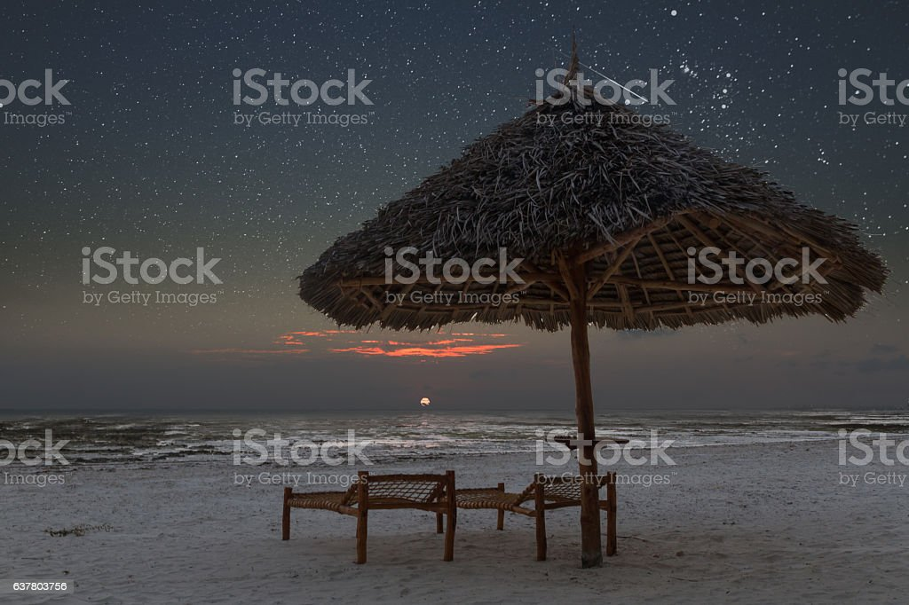 Sunrise in tropical beach of Zanzibar with starry sky stock photo