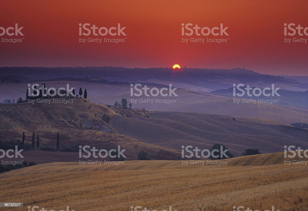 Sunrise in Tuscany, Italy coming up over the mountain stock photo