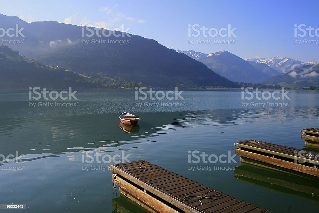 Sunrise in Zeller lake pier boat, Zell am See, Austria stock photo