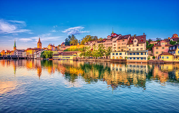 Sunrise in Zurich at the Limmat River Sunrise in the historic downtown of Zurich at the Limmat River . fraumunster stock pictures, royalty-free photos & images