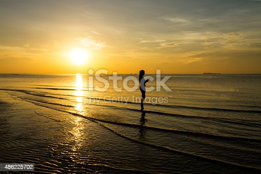 494377786istockphoto Sunrise lady relax 486225702