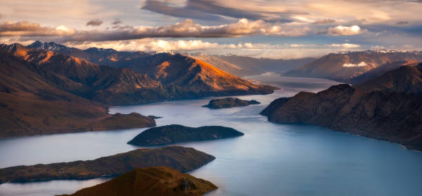 Sunrise landscape panoramic view of lake and mountains from Roy's peak, NZ stock photo